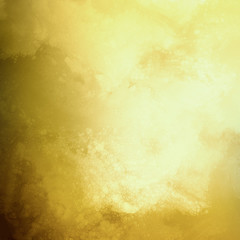 gold background with distressed marbled texture, elegant fancy yellow paper with textured vintage design of bokeh lights and grunge stains