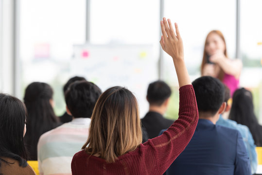 Student Raising Hand Up in a classroom.