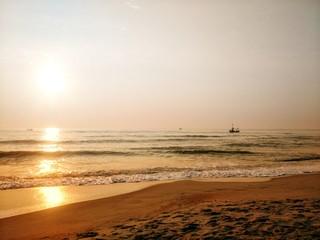 fisher boat on sunrise