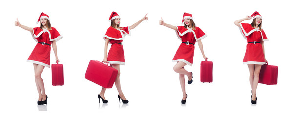 Young woman in red santa costume with suitcase
