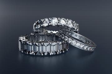 Three eternity wedding rings on black glossy background. 3D rendering