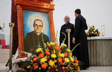 Roman Catholic Cardinal Leopoldo Brenes speaks next to a picture of the late Archbishop of San Salvador Oscar Arnulfo Romero during a mass at the Metropolitan Cathedral in Managua