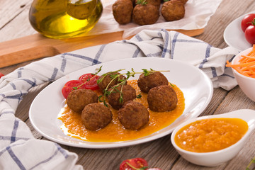 Meatballs with mashed carrots.