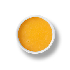 cup of orange dressing isolated on white, view from above