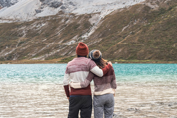 Hiking young couple traveler looking beautiful landscape at milk lake in Yading Nature Reserve, Travel lifestyle concept