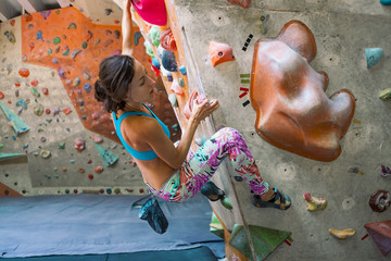 A woman trains to climb.