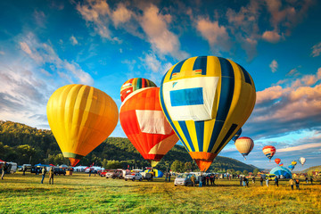 Colorful hot air balloons flying over the valley, Transylvania, Romania