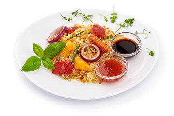 Fried mixed vegetables with rice and sauces, Chinese recipes WOK. Vegetarian food. Isolated on white background