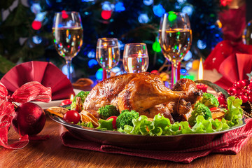 Baked or roasted whole chicken on Christmas table