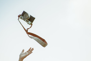 An old camera that floats on the air in stripe vintage.Old camera floating in the air