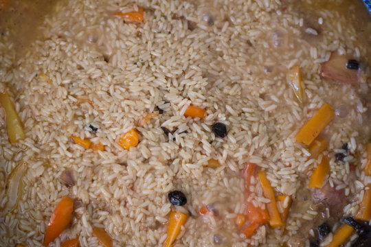 Rice pilaf with meat of a lamb, with stewed vegetables, onions, carrot and garlic