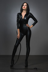 woman in latex suit on a dark background