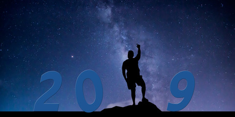 Newyear 2019 concept Silhouette young man hand up to 2019 new year