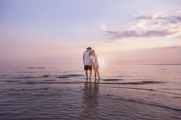 Young couple in love resting on the sea
