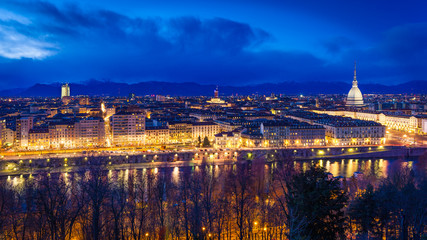 Panoramic view of Turin with Mole Antonelliana against snow capped Alps at dusk, Turin, Italy