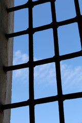 Window with metal bars: bottom-up view