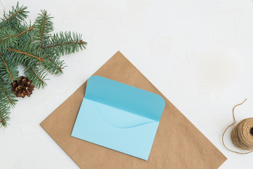 Christmas gifts, cute envelope on Christmas tree and garland background