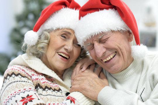 Portrait of a senior couple in Santa hats