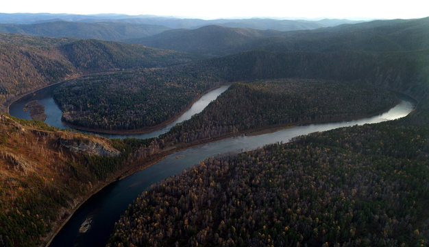 An aerial view shows the loops of the Mana River in the Siberian Taiga area outside Krasnoyarsk