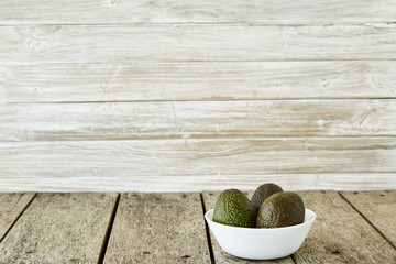 Avocado on old wooden background