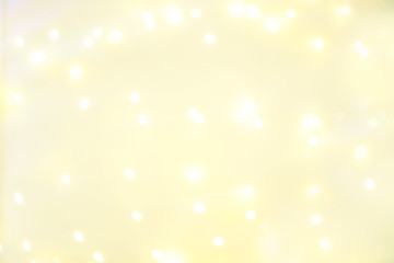 Goldn  Lights Festive background. Abstract Christmas twinkled bright background with bokeh defocused yellow lights