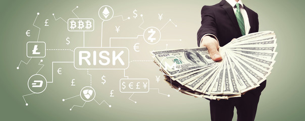 Cryptocurrency ICO risk theme with business man displaying a spread of cash