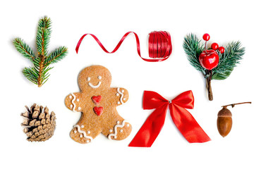 Isolated Christmas decorations, flat lay. Christmas composition with fir tree branches, gingerbread  Cookie  and holiday ornament on white background