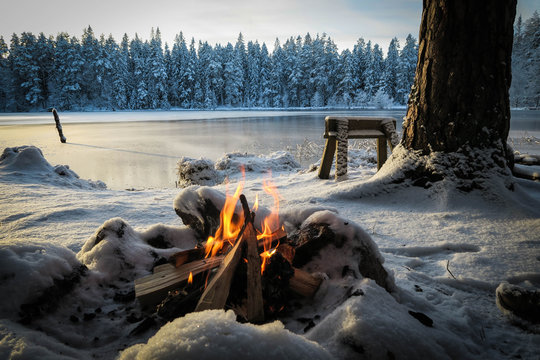 A camp fire at a frozen lake