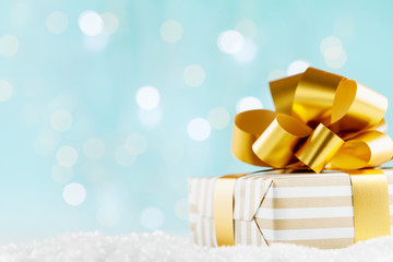 Gift or present box on magic bokeh background. Holiday composition for Christmas or New Year.