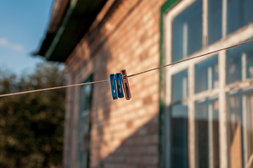 Plastic clothespins hanging on rope