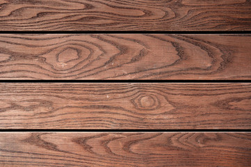 Weathered brown painted wooden board texture