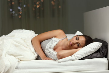 Insomniac woman can not sleep at home