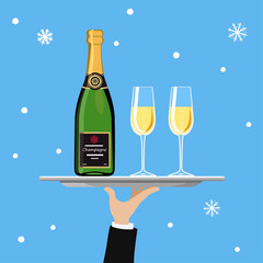 Bottle of champagne and glass on tray on blue background