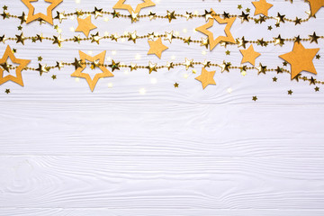 Border of big and small stars of confetti. Golden beads in the form of stars.