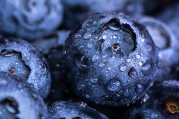 Fresh ripe blueberries with drops of dew. Berry background. Macro photo.