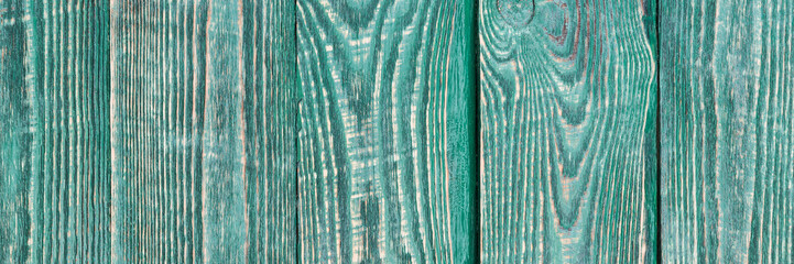 Background of wooden texture boards with a rest of paint of green color. Narrow.