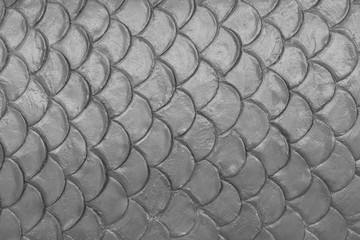 gray cement plaster in fish skin curve pattern wall background.