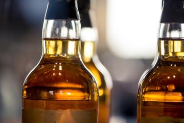 Whisky bottles, macro shot backlit