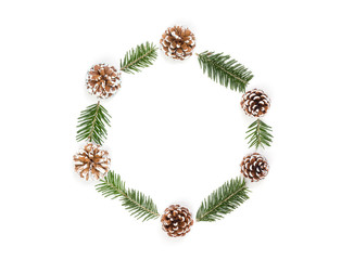 Christmas wreath of pine cones and fir branches isolated on white background. Flat lay, top view, copy space