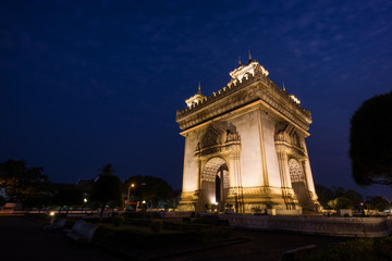 Lit Patuxai (Patuxay), Victory Gate or Gate of Triumph, war monument in Vientiane, Laos, at dusk.