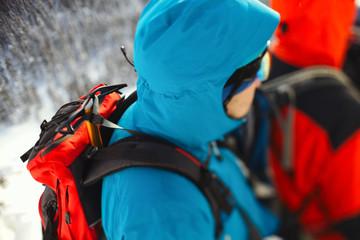 Foto op Aluminium Alpinisme Ice ax strapped on a backpack climber closeup. Tilt-shift effect.