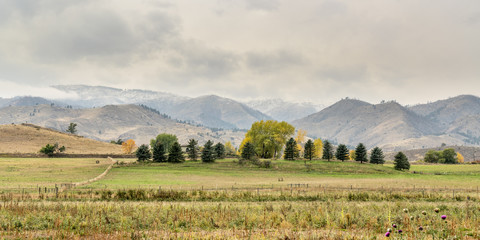 Snow clouds over foothills and farmland Fotobehang