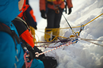 Fall protection mount climbers on the mountain slope, close-up.  Tilt-shift effect.