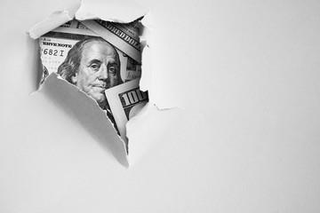 Bill of one hundred dollars under holed paper