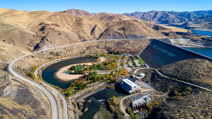 Aerial view of the dam on the Boise River in the fall time where the water behind is low