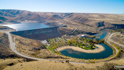 Earthen Dam in the Boise River and public park with fall colored trees