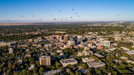 Aerial view of Boise Idaho with hot air balloons in the sky