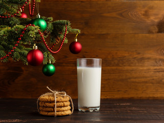 Milk and cookies for Santa Claus under the christmas tree. Concept, copy Space.