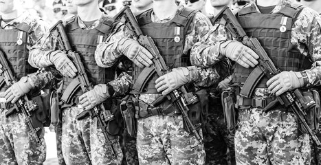March of defenders of Ukraine. Day of the defenders of Ukraine. closeup of soldiers with weapon