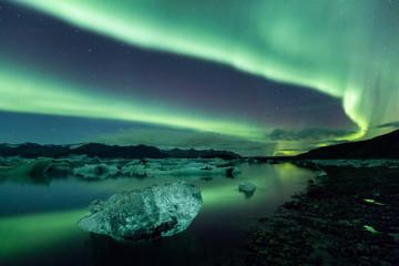 Aurora borealis dancing at Jokulsarlon glacier lagoon in Iceland